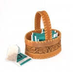 Basket of birch bark with a handle and pine cones